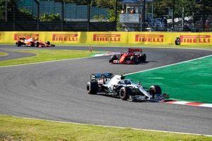 Valtteri Bottas, Mercedes AMG W10, leads Sebastian Vettel, Ferrari SF90, and Charles Leclerc, Ferrari SF90