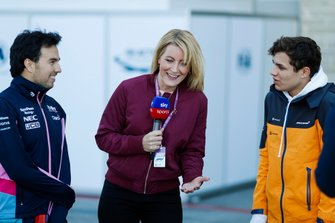 Sergio Perez, Racing Point, and Lando Norris, McLaren, play with radio controlled cars for Sky presenter Rachel Brookes