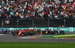 Charles Leclerc, Ferrari SF90, leads Sebastian Vettel, Ferrari SF90, Alexander Albon, Red Bull RB15, Lewis Hamilton, Mercedes AMG F1 W10, Max Verstappen, Red Bull Racing RB15, and the rest of the field at the start