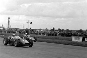 Roy Salvadori, Aston Martin DBR5/250, leads Dan Gurney, BRM P48
