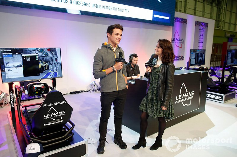 Lando Norris, McLaren is interviewed on the Le Mans eSports Series stand