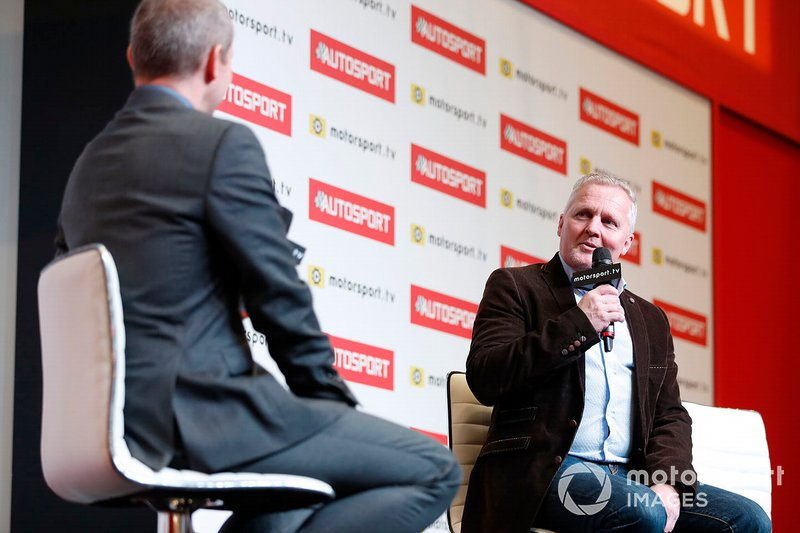Johnny Herbert is interviewed on the Autosport stage by presenter Stuart Codling