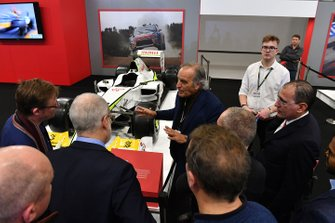 Giorgio Piola explains the technical details of the cars to fans on the Autosport stand