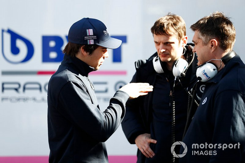 Lance Stroll, Racing Point talks to members of the team