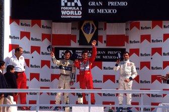 Podium: McLaren team owner Ron Dennis, second place Riccardo Patrese, Williams, Race winner Ayrton Senna, McLaren, Michele Alboreto, Lola