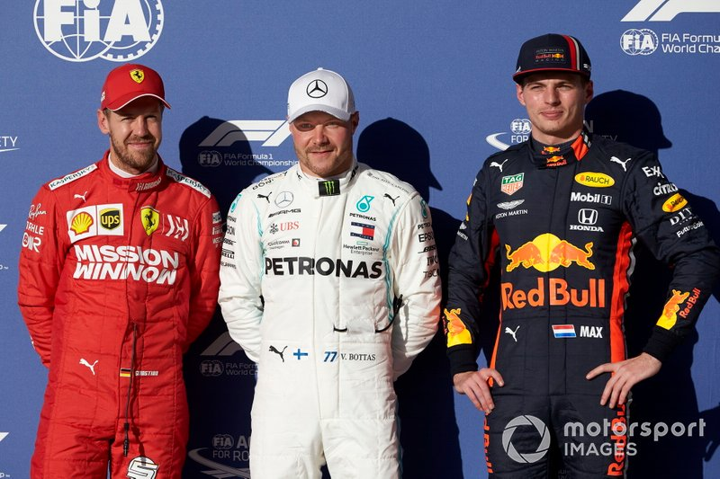 Top three Qualifiers Sebastian Vettel, Ferrari, pole man Valtteri Bottas, Mercedes AMG F1, and Max Verstappen, Red Bull Racing