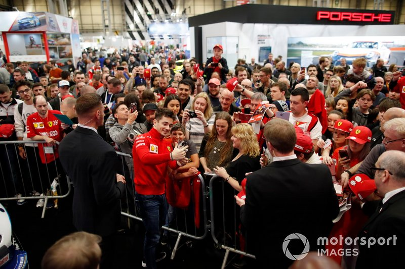 Charles Leclerc, Ferrari takes a selfie with a fan in front of the Autosport stage