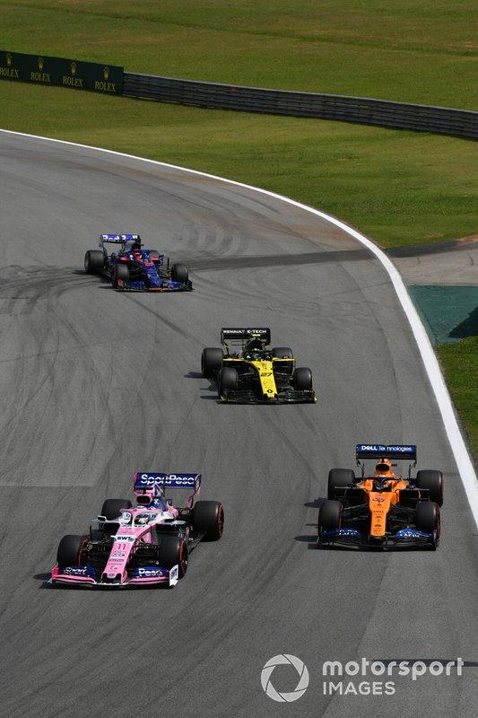 Sergio Perez, Racing Point RP19, leads Carlos Sainz Jr., McLaren MCL34, Nico Hulkenberg, Renault F1 Team R.S. 19, and Daniil Kvyat, Toro Rosso STR14