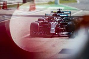 Valtteri Bottas, Mercedes F1 W11 Lewis Hamilton, Mercedes F1 W11 out of the pit lane