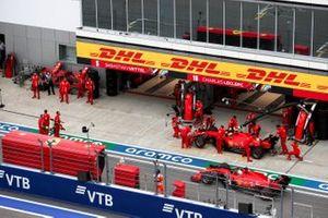 Charles Leclerc, Ferrari SF1000, and Sebastian Vettel, Ferrari SF1000, in the pit lane