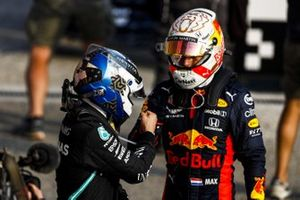 Pole Sitter Valtteri Bottas, Mercedes-AMG F1 and Max Verstappen, Red Bull Racing celebrate in Parc Ferme