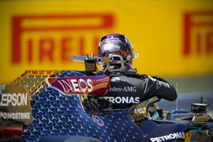 Lewis Hamilton, Mercedes-AMG F1, climbs out of his car after taking pole