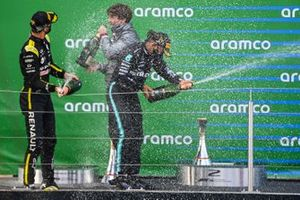 Daniel Ricciardo, Renault F1, 3rd position, and Lewis Hamilton, Mercedes-AMG F1, 1st position, celebrate on the podium with Champagne