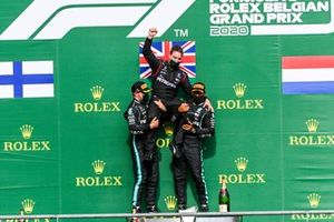 Valtteri Bottas, Mercedes-AMG F1, 2nd position, and Lewis Hamilton, Mercedes-AMG F1, 1st position, hoist the Mercedes Constructors trophy representative onto their shoulders on the podium