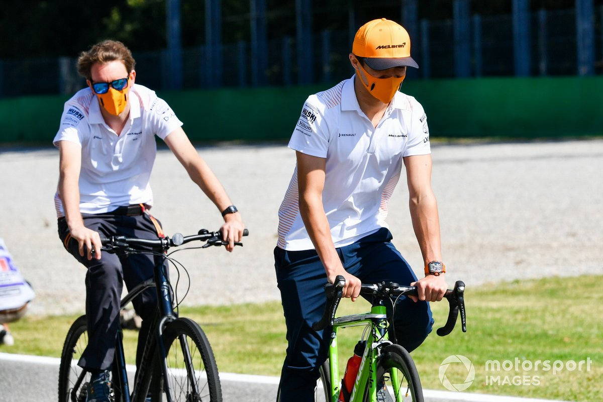 Lando Norris, McLaren, cycles the track