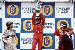 Podium: race winner and World Champion Alain Prost, second place Nelson Piquet, third place Stefan Johansson