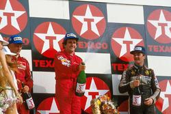 Podium: race winner Alain Prost, second place Niki Lauda, third place Nigel Mansell