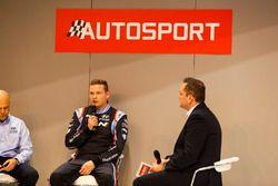 Hyundai development driver Jari Huttunen on stage, with M-Sport and Hyundai representatives
