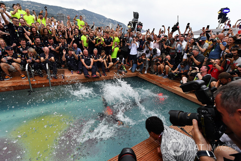 Daniel Ricciardo, Red Bull Racing celebrates in the Red Bull Energy Station swimming pool