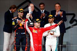 Sebastian Vettel, Ferrari, raises his second place trophy