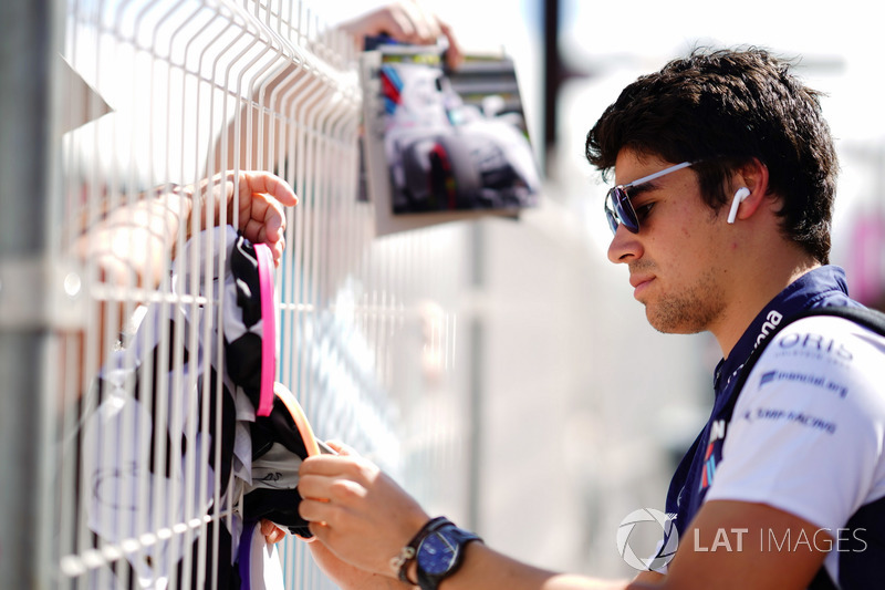 Lance Stroll, Williams Racing, signs autographs for fans