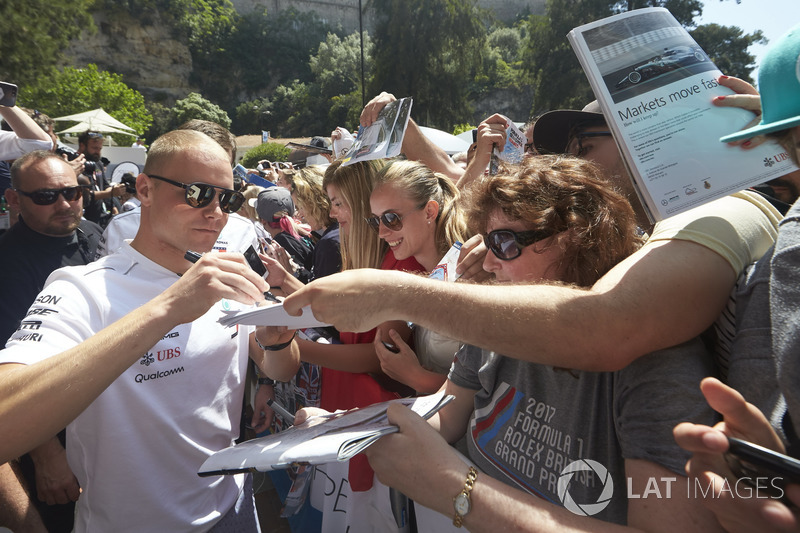 Valtteri Bottas, Mercedes AMG F1, signs autographs