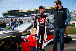Clint Bowyer, Stewart-Haas Racing Ford, Rutledge Wood, and Cash Bowyer