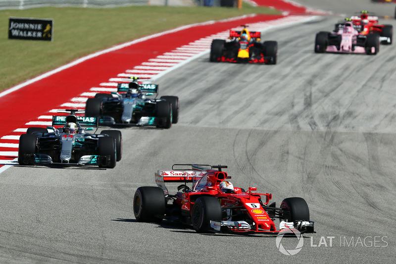 Sebastian Vettel, Ferrari leads Lewis Hamilton, Mercedes AMG F1 W08