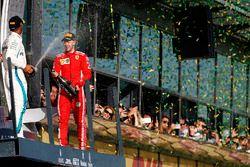 Lewis Hamilton, Mercedes AMG F1, 2nd position, and Sebastian Vettel, Ferrari, 1st position, celebrat