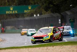 Chaz Mostert, Tickford Racing Ford, leads Nick Percat, Brad Jones Racing Holden