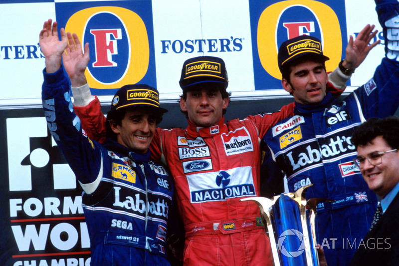 Podium: second place Alain Prost, Williams, Race winner Ayrton Senna, McLaren, third place Damon Hill, Williams