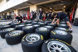 ART Grand Prix mechanics prepare Pirelli tyres