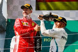 Sebastian Vettel, Ferrari celebrates by spraying champagne on the podium with Lewis Hamilton, Mercedes AMG F1