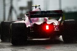 The rain light flares on the car of Esteban Ocon, Force India VJM11
