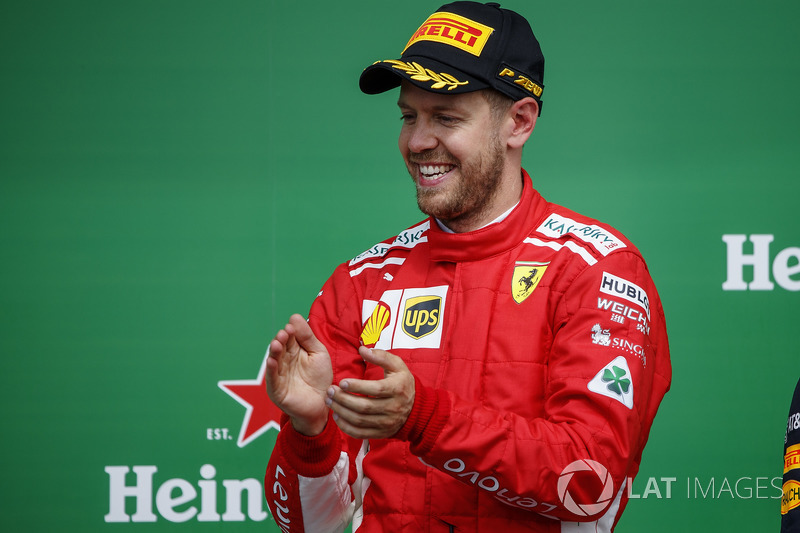 Sebastian Vettel, Ferrari, 1st position, celebrates on the podium