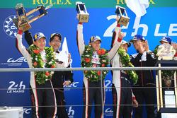 Overall podium: second place Mike Conway, Kamui Kobayashi, Jose Maria Lopez, Toyota Gazoo Racing