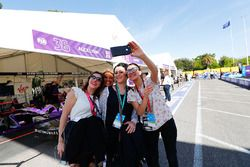Fans take a selfie with the garage of Alex Lynn, DS Virgin Racing