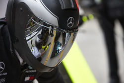 Reflection in a Mercedes pit crew members visor