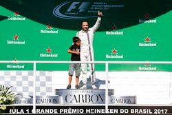 Felipe Massa, Williams, waves to the fans from the podium with his son Filipinho