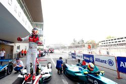 Daniel Abt, Audi Sport ABT Schaeffler, celebrates after winning the race as Oliver Turvey, NIO Formula E Team, climbs from his car