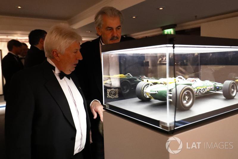 Herbie Blash and Gordon Murray admire a model of a Jim Clark Indianapolis Lotus