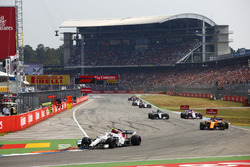 Charles Leclerc, Sauber C37, leads Fernando Alonso, McLaren MCL33, Esteban Ocon, Force India VJM11, and Lewis Hamilton, Mercedes AMG F1 W09