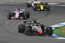 Romain Grosjean, Haas F1 Team VF-18, leads Sergio Perez, Force India VJM11, and Carlos Sainz Jr., Renault Sport F1 Team R.S. 18