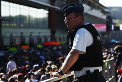 A policeman watches the pit walk