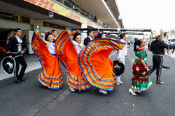 Dancers and a mariachi band outside the garages of Fernando Alonso and Stoffel Vandoorne, McLaren