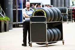 A McLaren mechanic with Pirelli tyres