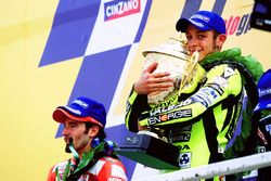 Podium: winner Valentino Rossi, Honda Team, second place Max Biaggi, Yamaha Team