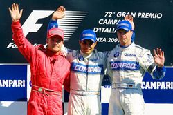 Podium: second place Rubens Barrichello, Ferrari; Winner Juan Pablo Montoya, Williams-BMW; third place Ralf Schumacher, Williams