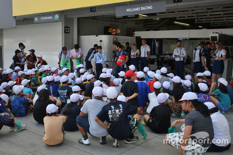 Young fans with the Williams team