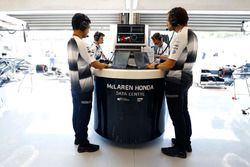 Ciaron Pilbeam, McLaren Chief Race Engineer works alongside colleagues in the pit garage.